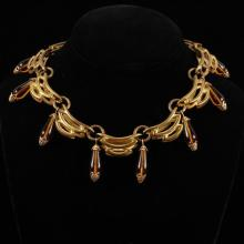 French Art Deco / Machine Age Brass Modernist Collar Necklace with amber colored poured glass drops.