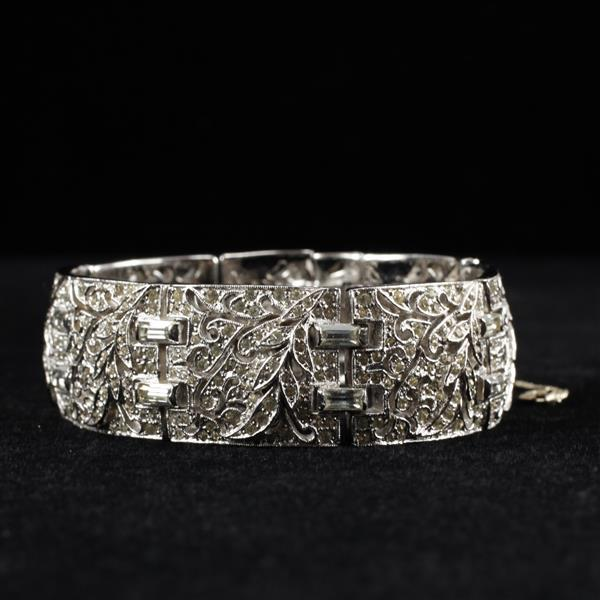 Unmarked Art Deco Pave Rhinestone Rhodium Plated Wide Bracelet with pierced scrolling floral links.