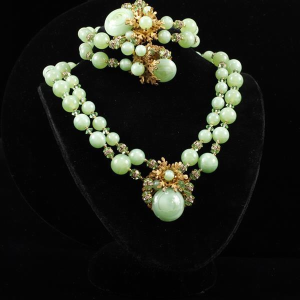 Miriam Haskell 2pc Set; green glass necklace & bracelet with gilt snowflakes.