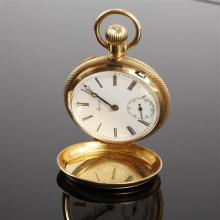 Agassiz 18K Yellow Gold Hunter Case Pocket Watch with chased decoration.