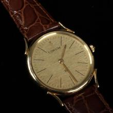 Corum 18K yellow gold men''s watch with original buckle standard ''out of the box'' length