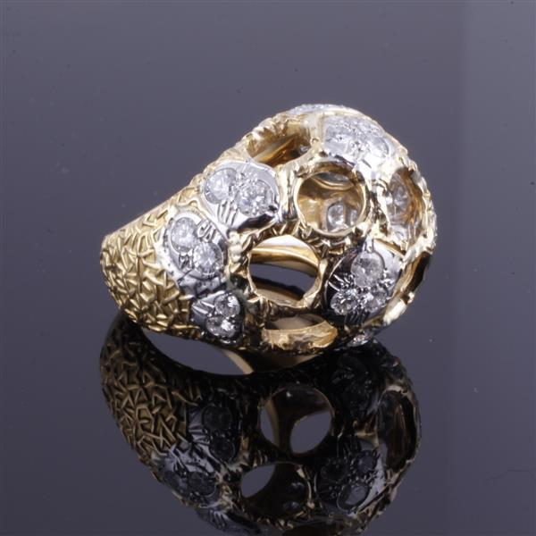 Yellow gold 18K and platinum and diamond modern open moon crater dome ring with textured shank.