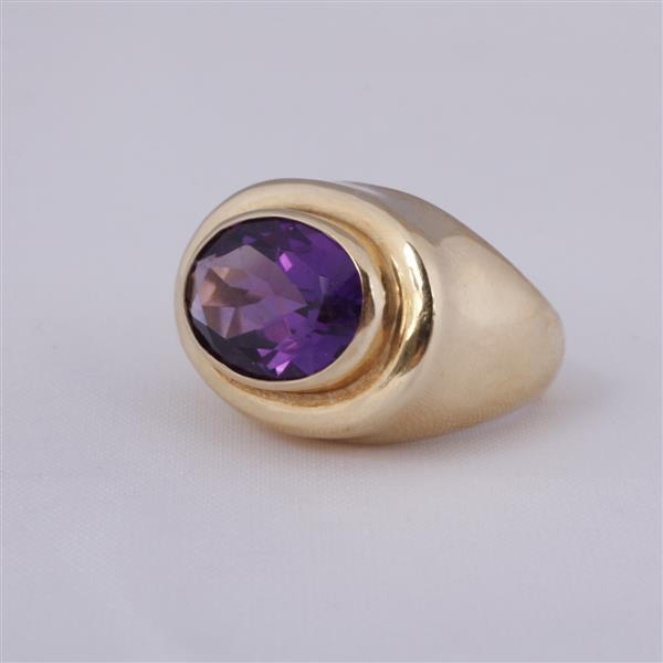 Yellow gold 14k vintage modern faceted oval amethyst estate ring.