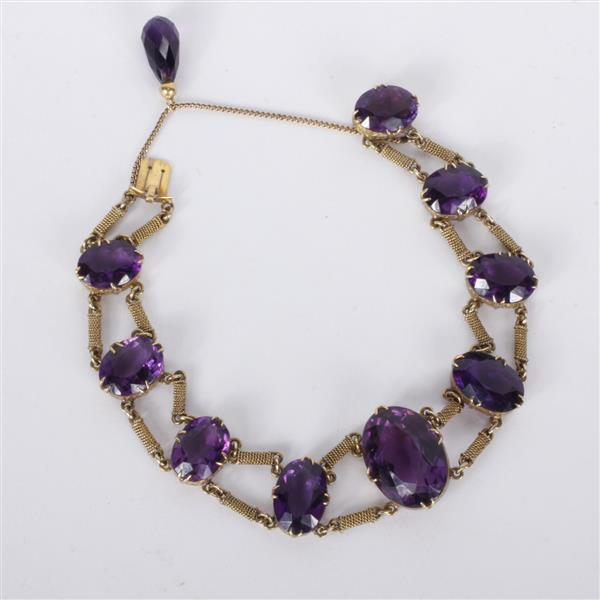 Antique Edwardian yellow gold 14K Amethyst Bracelet with tear drop pendant on chain and filigree wrapped spacer links.