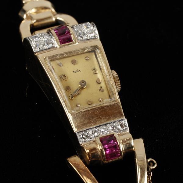 Trabert Hoeffer Mauboussin 14K Gold ladies watch; retro design with pave diamond and ruby on double box chain bracelet 6
