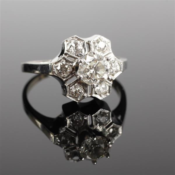 White gold 14k Diamond Ring; Geometric Floral design with approx. 63 point center stone; 1cttw.