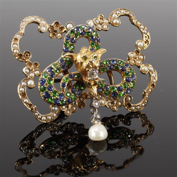 Yellow gold vintage estate brooch; figural gargoyle head and serpent with diamonds, sapphire, green garnet and pearl in open cartouc...