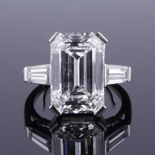GIA Certified 9.3 carat Emerald Cut Diamond with Classic Platinum 3 Stone Ring Mount