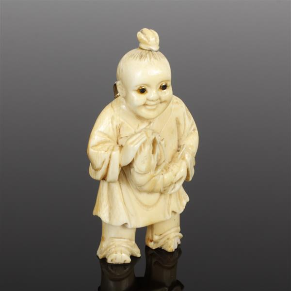 Carved Ivory Netsuke figure mounted as pendant in gold with glass eyes.