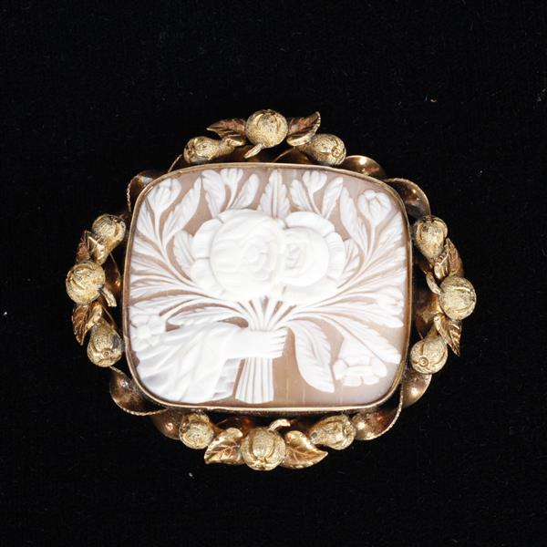 Victorian Figural Hand holding Flowers Shell Cameo Pin in Two tone rose gold fruit layered twist mount.