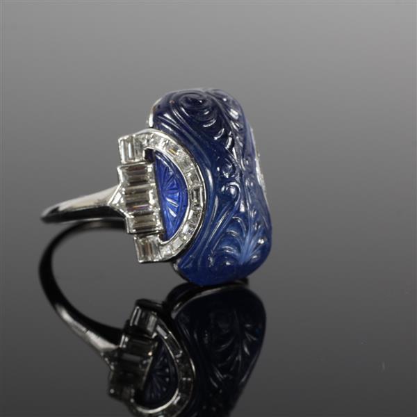 Art Deco platinum minimum 15ct. carved sapphire cabochon and diamond ring.