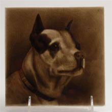 English ceramic brown glaze portrait tile of a dog with clipped ears. Marked M661