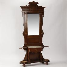 Victorian hall tree with mirror, marble topped drawer and two cast iron umbrella trays.