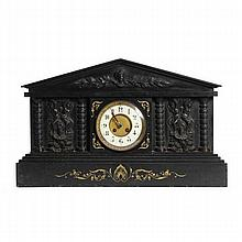 Large black marble mantel clock with Neo Classical figural relief carving.
