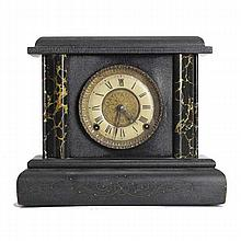 Mantel clock; ebonized case with faux marble trim.