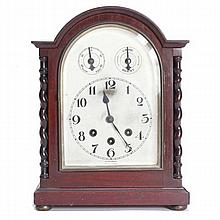 Georgian style mahogany case mantel clock with barley twist columns; dial marked, 'Wurtemberg, Made in Germany'.
