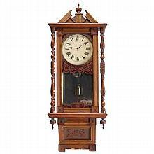 Vienna wall clock; walnut and mixed wood case.