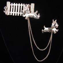 Vintage Retro 1930s Sterling Silver Scotty Dogs Sweater Pin with blue rhinestone accents.