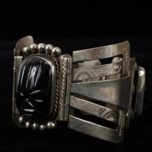Vintage Mexican Silver Carved Black Onyx Tribal Figural Faces Hinged Cuff Bracelet.