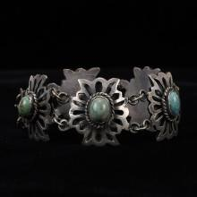 Mexican Sterling Silver and Turquoise Link Bracelet with Modernist Sunburst Design.