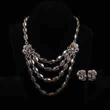 Tortolani 2pc. Silvertone Putti / Cherubs Bib Necklace & Clip Earrings set.