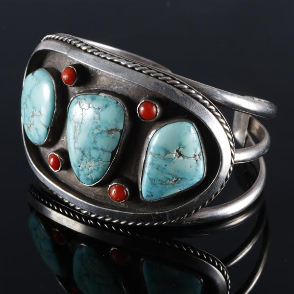 Native American Navajo Indian sterling silver cuff bracelet with turquoise nuggets and coral cabochons in shadowbox.