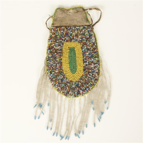Native American Plains Indian multicolored heavily beaded leather pouch bag with bead fringe.