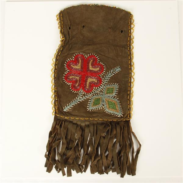 Native American Indian beaded flower brown leather pouch .