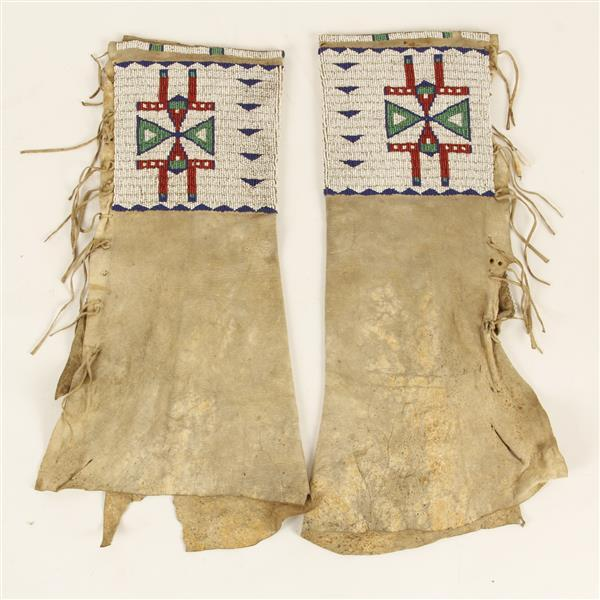 Exceptional Sioux Native American Indian heavily beaded leather leggings, c. 1880.