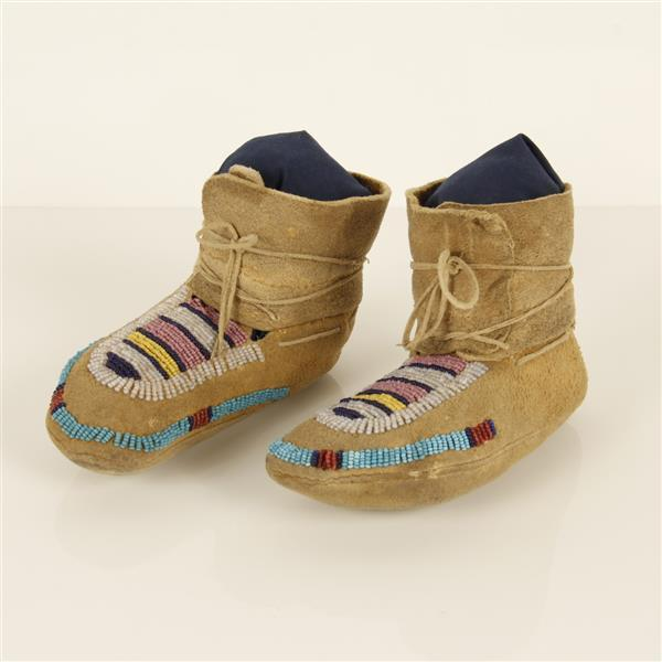 Crow Native American Indian child's beaded high top moccasin, c. 1880-1890.
