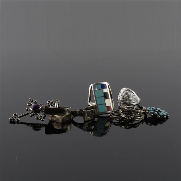 Collection of Native American Southwestern sterling silver and turquoise jewelry.