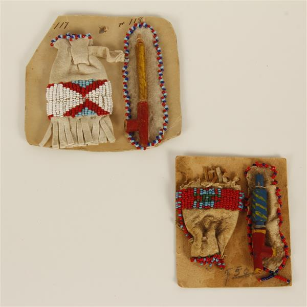 Pair of Sioux Native American Indian reservation miniature tourist pieces, pipe and bag.