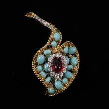 Kenneth J. Lane (KJL) Jeweled gold tone leaf brooch pin with turquoise and ruby poured glass stones.