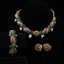 Boucher 3pc. Moderne Parure; emerald green and clear rhinestone Art Deco Twist set, necklace, bracelet, ear clips.