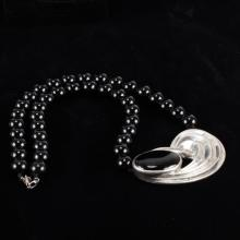 Modernist sterling silver and onyx beaded necklace.