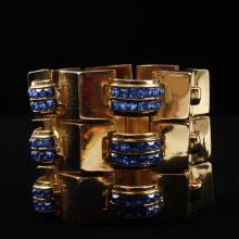 Coro Retro gold-tone and blue rhinestone wide cuff bracelet.