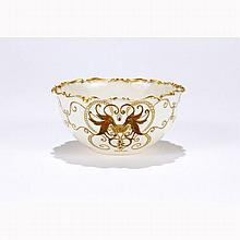 Fine eggshell porcelain bowl decorated with raised gilt and beaded enamel, stylized drinking birds; shaped curl rim.