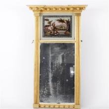 Gilt federal style eglomise mirror with rural landscape scene.