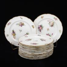 Set of twelve French Feuillet hand painted porcelain luncheon plates, 19th century.