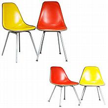 Set of four Eames for Herman Miller vinyl covered fiberglass chairs; orange and yellow.