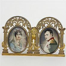 Two hand-touched portrait miniatures on celluloid of Napoleon and Josephine in gilt metal frame.