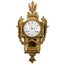 A Louis XVI Ormolu Cartel Clock