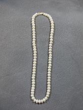 Necklace, pearls with 14 k gold clamp