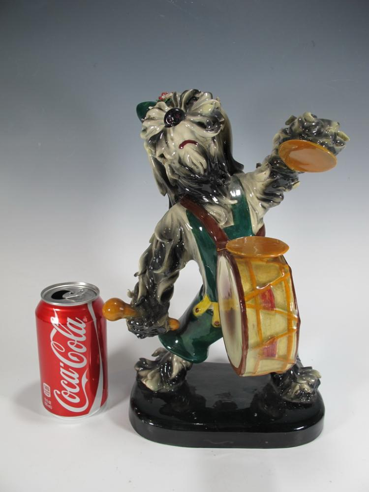 Antique Italian dog playing drum faience