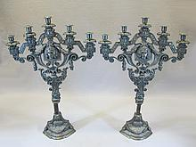 Antique pair of religious bronze candelabras