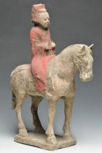 A Painted Pottery Equestrian Figure, Tang Dynasty