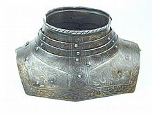 A late 16th Century Gorget, composed of four lames, the upper with turned and roped edge, the front and rear sections pivoting on a hinge to the inside, left of the collar and secured by a keyhole and stud on the right outside, the whole with etched