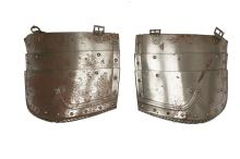 A pair of late 19th or early 20th Century tassets, each composed of three lames with turned and roped edges, embossed gulley decoration.