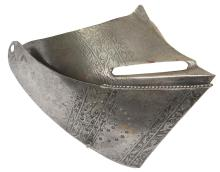 A 16th Century etched Italian Visor and Bevor, the bevor etched with three linear panels of scrolling foliage and pierced with circular breaths to the right side, turned and roped upper edge, the visor etched to match.
