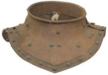 A Victorian copy of a 17th Century Gorget, the two-piece neck with guttered and turned edge, domed rivet decoration, hinged to the left side and secured by a keyhole slot and stud mechanism.